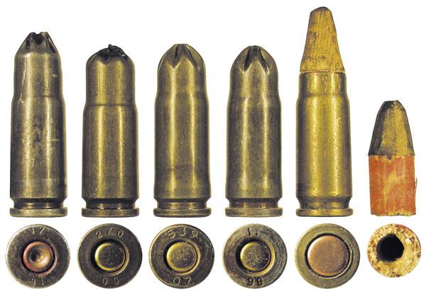 Различные холостые патроны: 1— штатный армейский патрон 7Х5; 2— переделанный на киностудии патрон 7Х5; 3 — серийный патрон в биметаллической гильзе, выпускавшийся для кино; 4-7— кустарные холостые патроны, переобжатые из гильз патрона 5,45х39; 8— самодельный холостой патрон с деревянной пулей